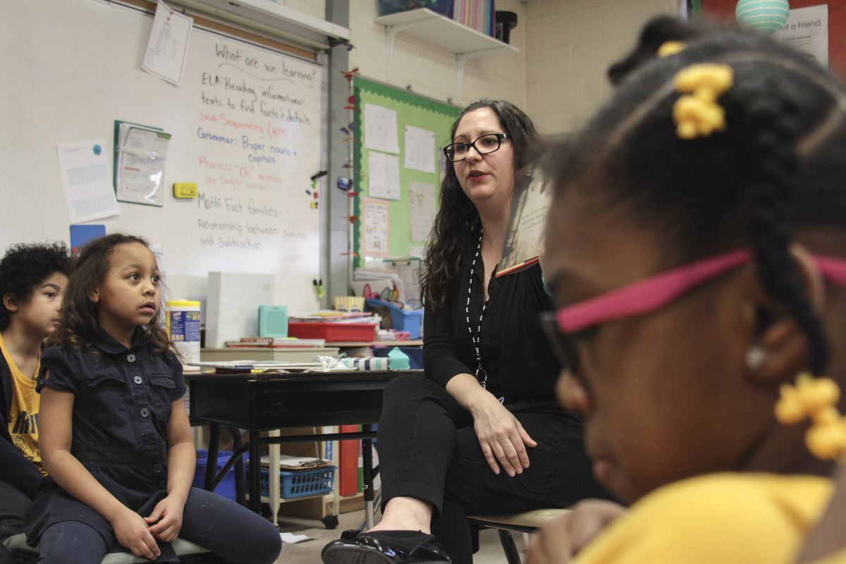 First grade teacher Randy Foust reads to her students at Washington Irving Elementary School.
