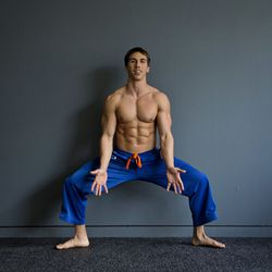 <b>Squat jacks</b><br> A jumping jack/squat hybrid, this explosive move will work your butt, thighs, calves, and shoulders. <br> Step 1: Start in a wide-stance squat with your toes pointing outward. This will look like your sumo squat, but for this exer
