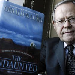 """Gerald Lund stands by his book """"The Undaunted"""" at Deseret Book's offices in Salt Lake City."""