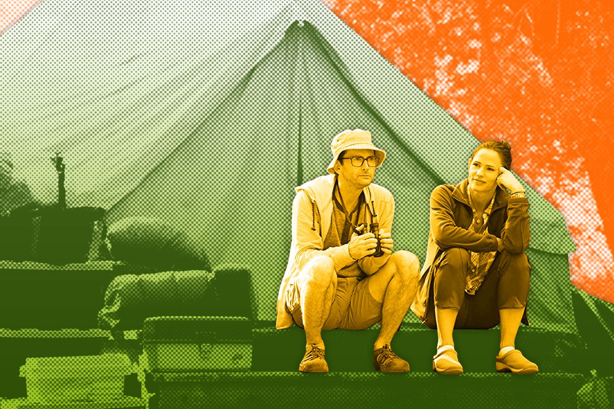 A man and a woman sitting outside a tent in 'Camping'