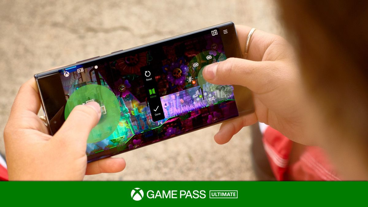 shot of a user holding a mobile phone and playing Guacamelee! 2 with touch controls