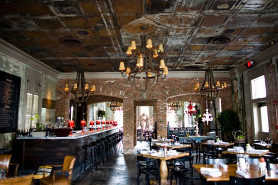 A dining room with aged cool old ceilings.