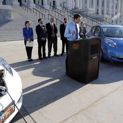 Jared Campbell, electric vehicle owner, speaks during a press briefing concerning alternative fuel vehicle strategies at the Capitol in Salt Lake City, Wednesday, Aug. 7, 2013.