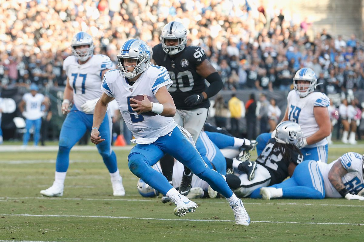 Quarterback Matthew Stafford of the Detroit Lions runs the ball toward the end zone in the fourth quarter against the Oakland Raiders at RingCentral Coliseum on November 03, 2019 in Oakland, California.