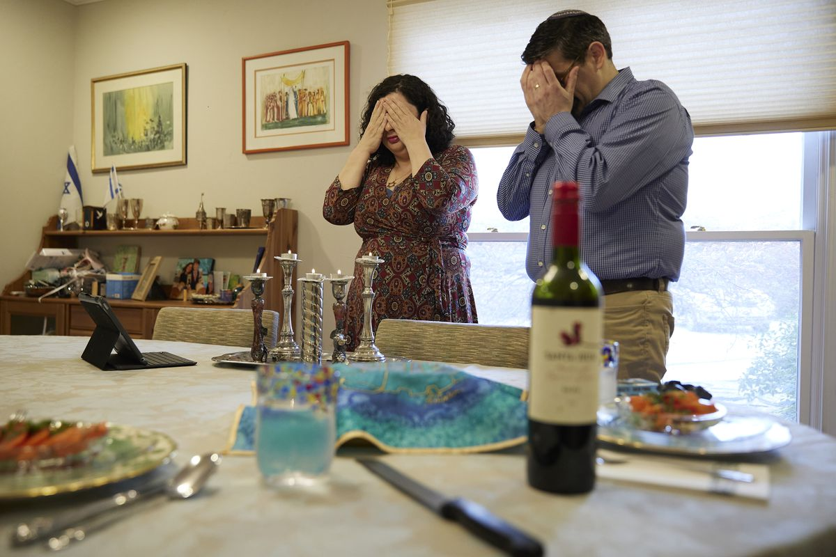"""Rabbi Ruth Abusch-Magder and her husband David Abusch-Magder perform the """"Blessing of the Candles"""" as they celebrate Shabbat on Friday evening at their home in Sandy Springs, GA. (Chris Aluka Berry for the Deseret News)"""