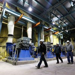 A group walks through the recycle pump room at the Huntington power plant in Huntington, Tuesday, March 24, 2015.