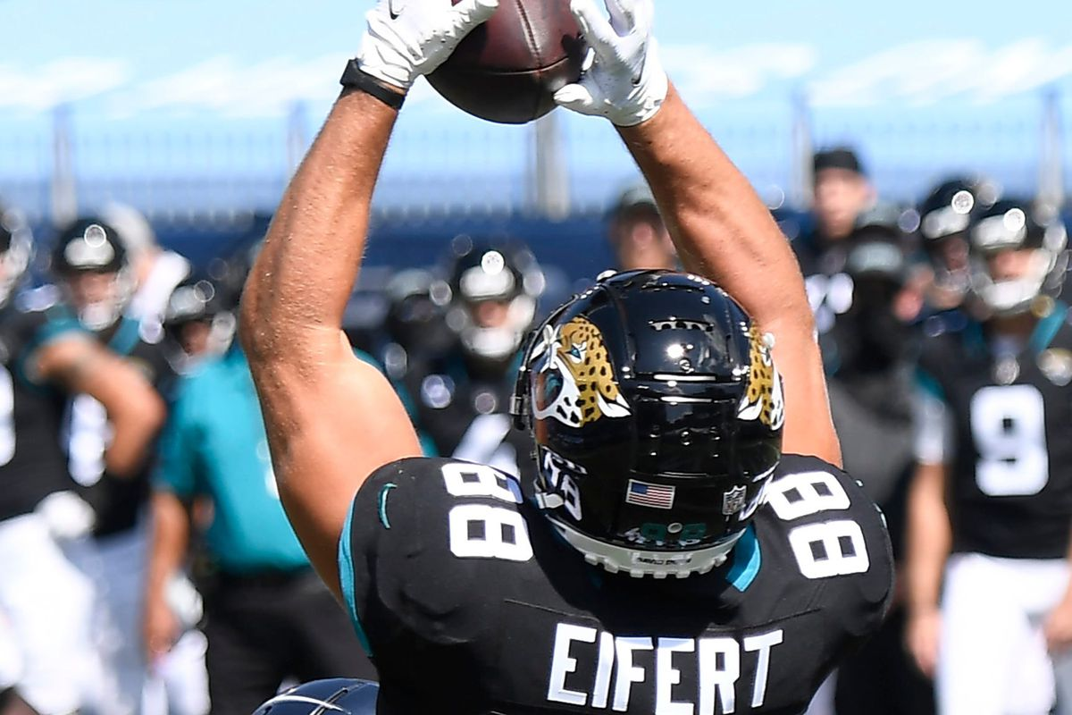 Jacksonville Jaguars tight end Tyler Eifert (88) pulls in a touchdown catch over Tennessee Titans strong safety Kenny Vaccaro (24) during the first quarter at Nissan Stadium