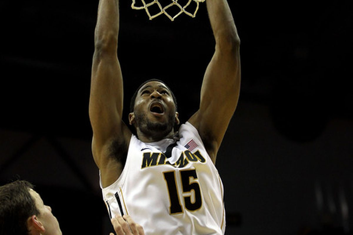 COLUMBIA, MO - DECEMBER 15:  Kadeem Green #15 of the Missouri Tigers dunks over Aaron Anderson #15 of the Kennesaw State Owls during the game on December 15, 2011 at Mizzou Arena in Columbia, Missouri.  (Photo by Jamie Squire/Getty Images)