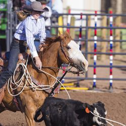 Sammy Taylor ropes a calf during the Utah High School Rodeo Finals in Heber City on Saturday, June 3, 2017.