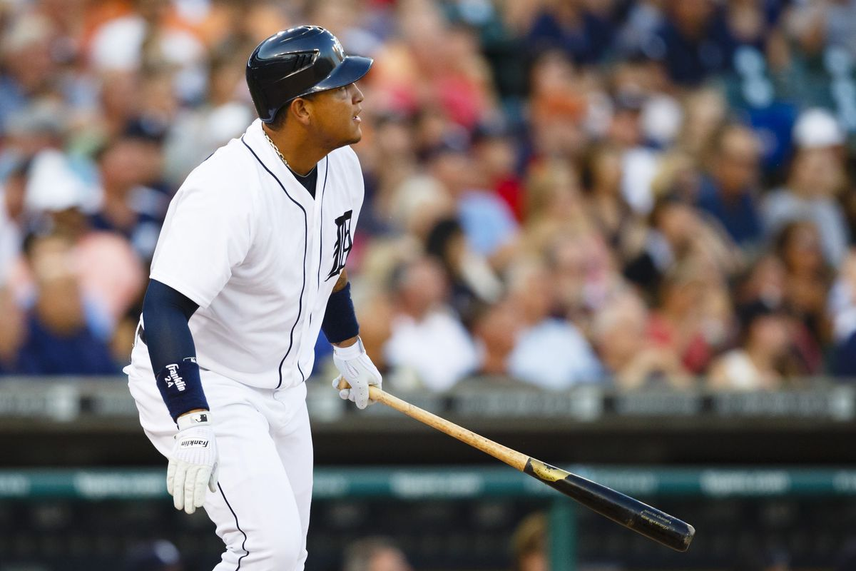 Detroit Tigers third baseman Miguel Cabrera (24) hits a home run during the fourth inning against the New York Yankees at Comerica Park. Mandatory Credit: Rick Osentoski-US PRESSWIRE