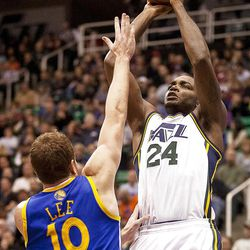Jazz forward Paul Millsap (24) goes up for a shot over Warrios forward David Lee (10) during the first half of the NBA basketball game between the Utah Jazz and the Golden State Warriors at Energy Solutions Arena, Wednesday, Dec. 26, 2012.