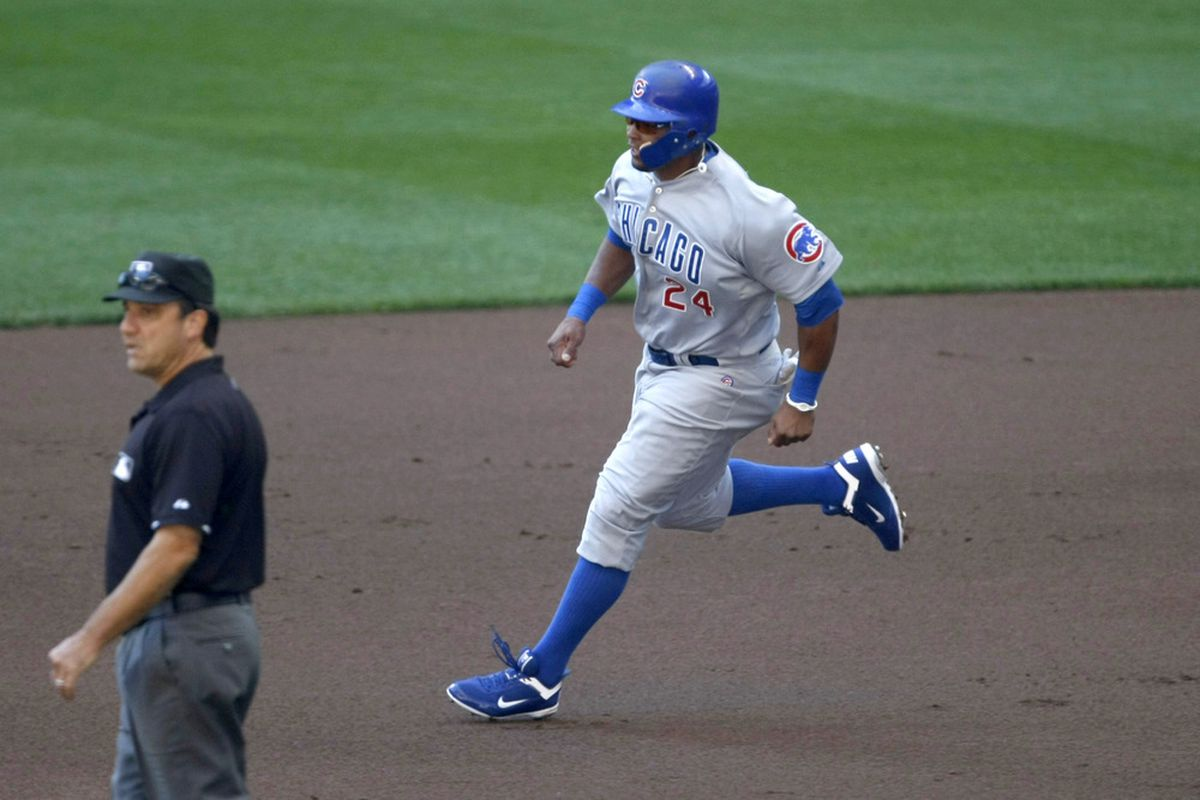 Marlon Byrd of the Chicago Cubs runs during a game against the Milwaukee Brewers at Miller Park in Milwaukee, Wisconsin. (Photo by Scott Boehm/Getty Images)
