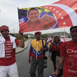 Activists carry a banner with a portrait of Venezuela's President Hugo Chavez during a protest against the sixth Summit of the Americas in Cartagena, Colombia, Saturday April 14, 2012. The summit brings together presidents and prime ministers from Canada, the Caribbean, Latin America and the U.S.  Chavez did not attend the summit on the advice of his doctors as he continues with cancer treatment.