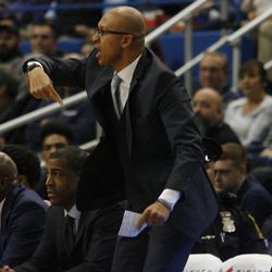 UConn associate head coach Raphael Chillious  yells out instructions to the defense.