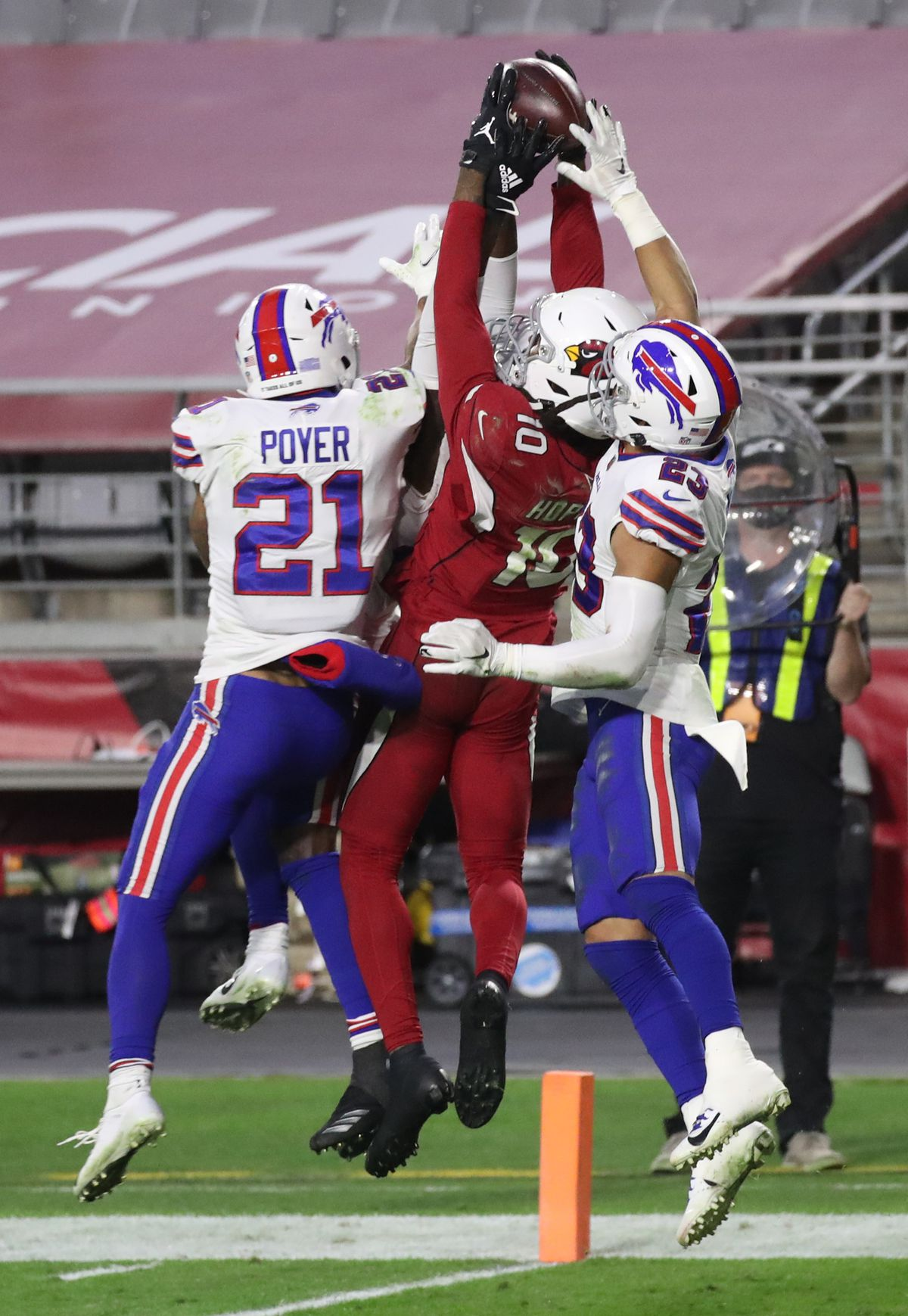 DeAndre Hopkins hauls down the ball while surrounded by Bills