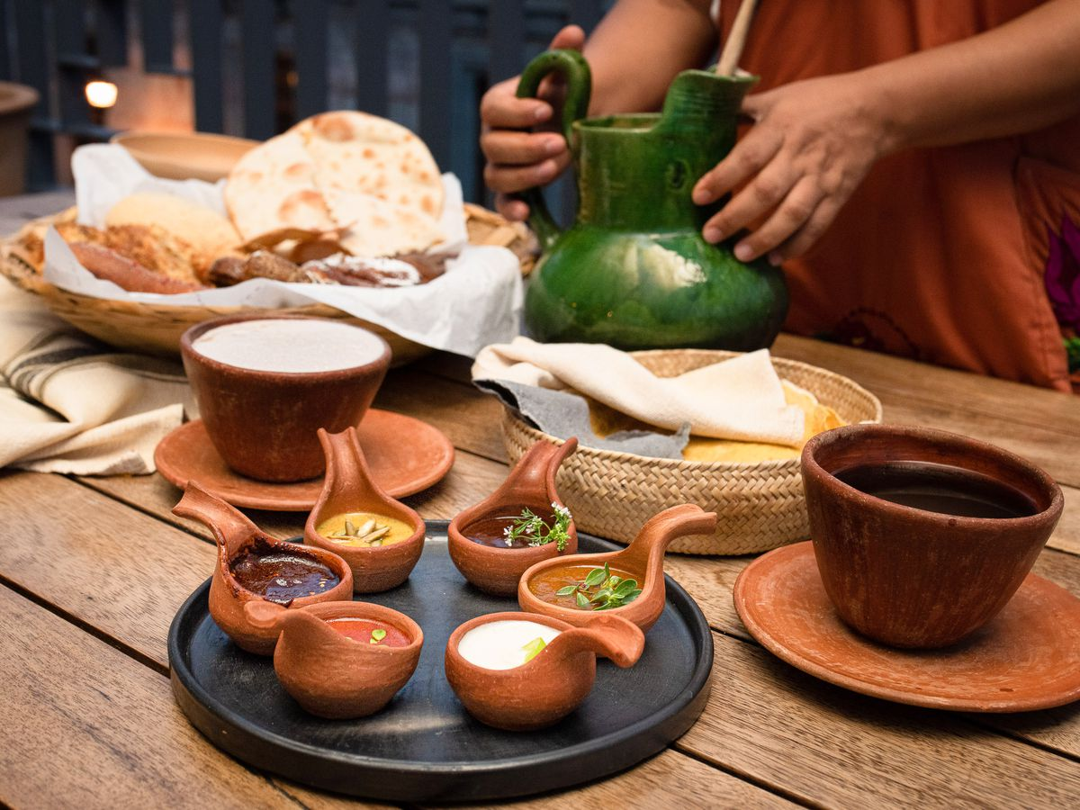 Several small terra cotta dishes on a table.