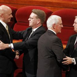 General authorities shake hands after the 182nd Annual General Conference for The Church of Jesus Christ of Latter-day Saints at the LDS Conference Center in Salt Lake City on Saturday, March 31, 2012.