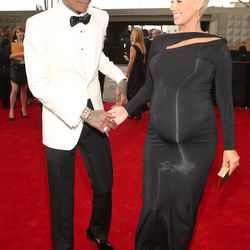 Wiz in a Tom Ford tux with a three-weeks-out Amber Rose in Donna Karan.