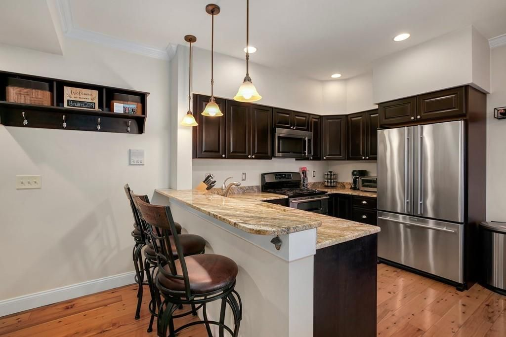 Another angle on that kitchen, showing the U-shaped counter and the fridge.