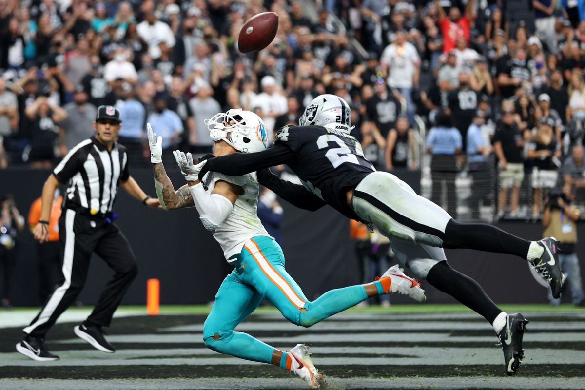 Johnathan Abram #24 of the Las Vegas Raiders defends against a pass to the end zone intended for William Fuller V #3 of the Miami Dolphins in overtime of the game at Allegiant Stadium on September 26, 2021 in Las Vegas, Nevada.