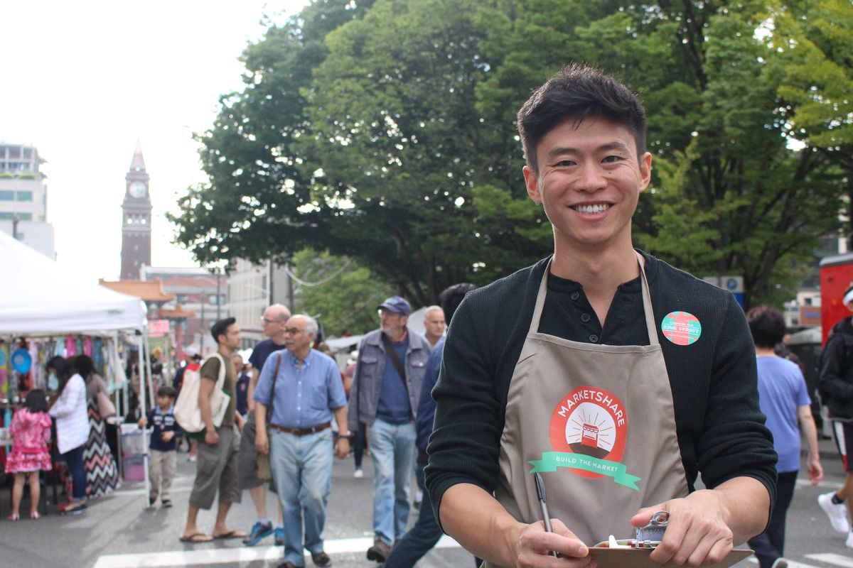 MarketShare founder and executive director, Philip Deng, collecting signatures of support for constructing an international street food market at King Street Station