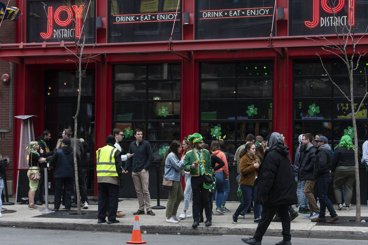 Despite the cancellation of St. Patrick's Day celebrations Saturday amid concerns about the spread of coronavirus, people line up outside bars in River North to celebrate.