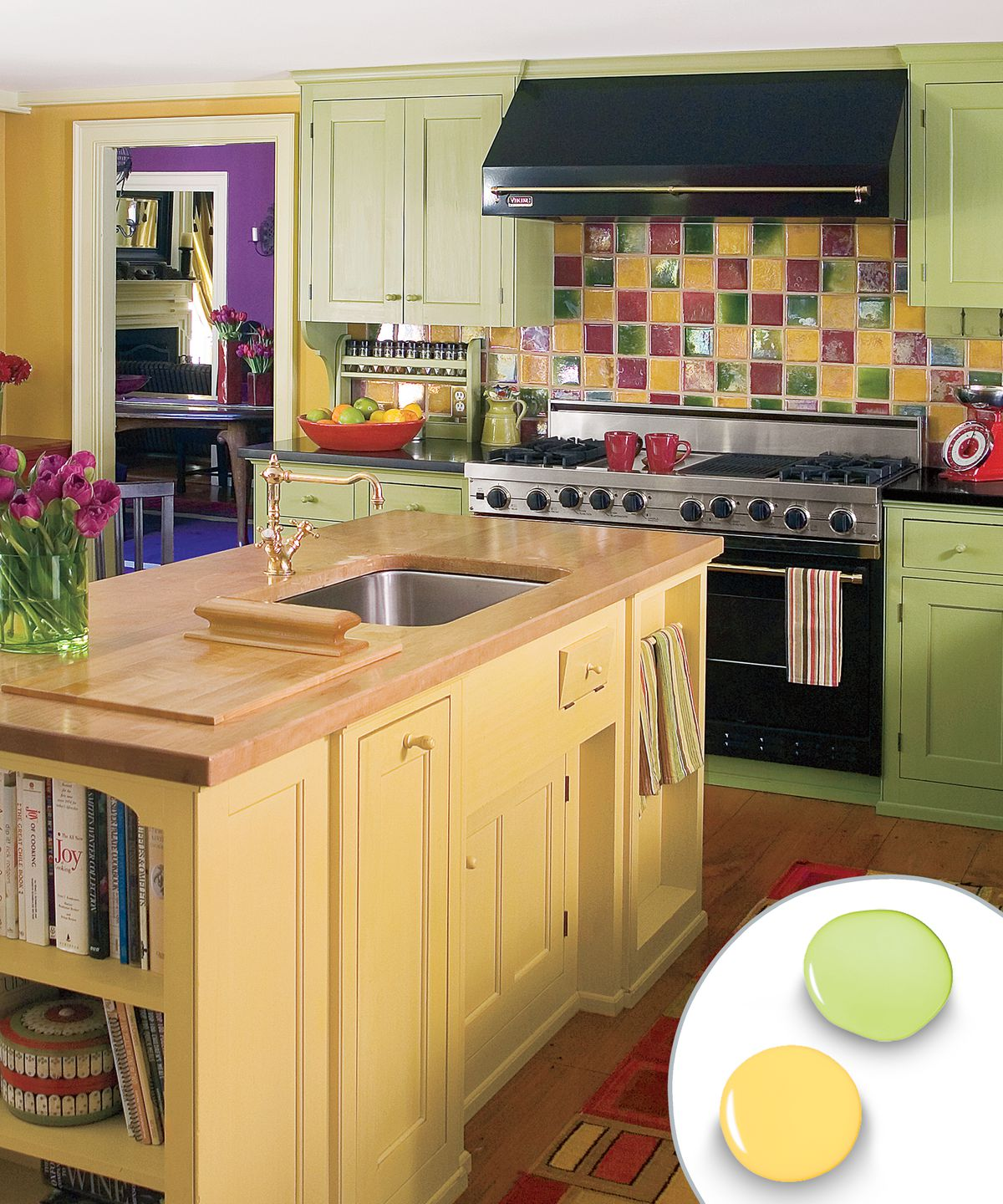 Multicolor kitchen color scheme with light yellow kitchen island and green cupboards.