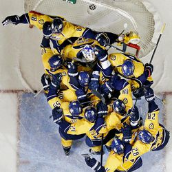 Nashville Predators players knock the net loose as they swarm goalie Pekka Rinne, of Finland, after they beat the Detroit Red Wings 2-1 in Game 5 of a first-round NHL hockey playoff series on Friday, April 20, 2012, in Nashville, Tenn. The Predators won the series 4-1.
