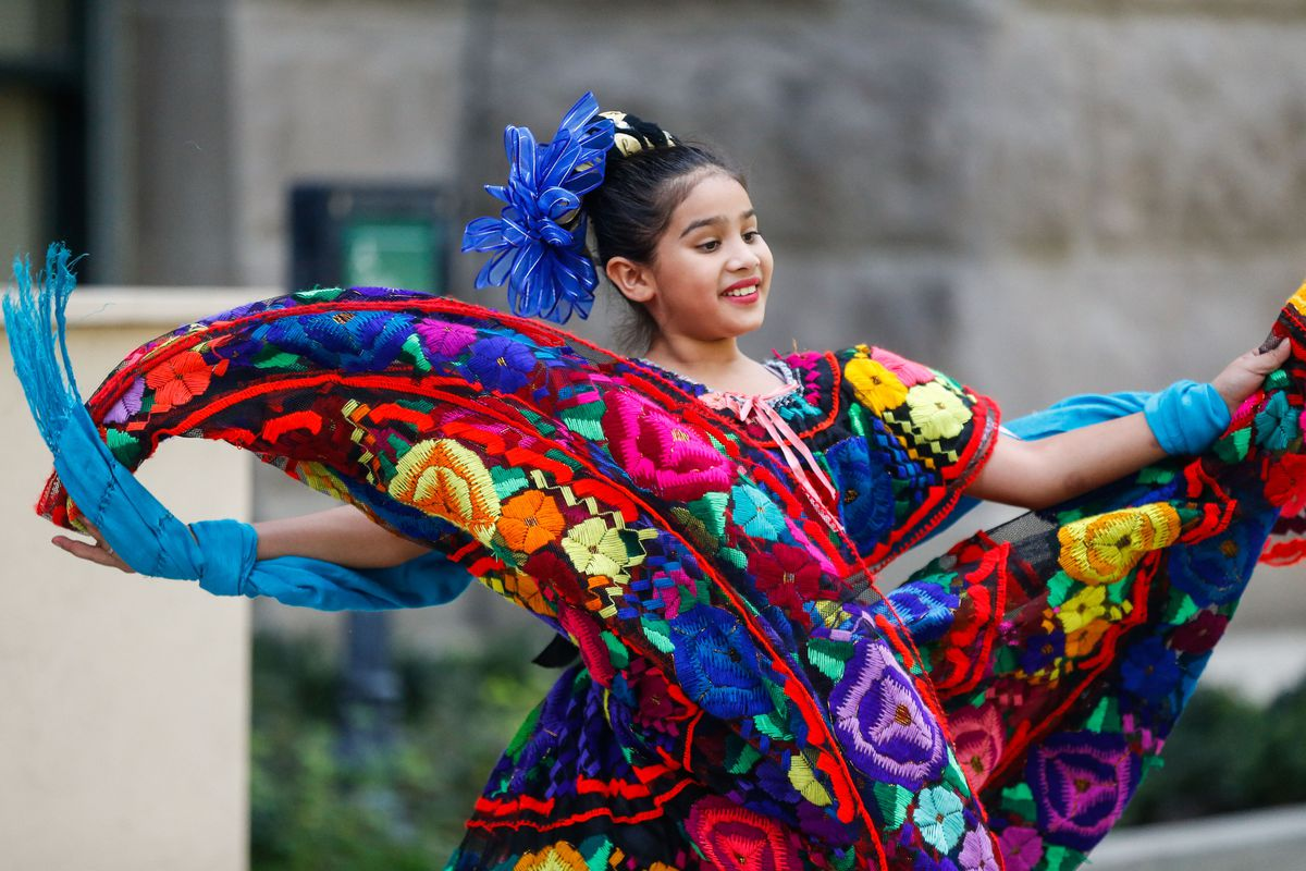 Miley Silos, 11, performed traditional ballet folk at the Salt Lake City-County Building in celebration of the start of Hispanic Heritage Month on Wednesday.
