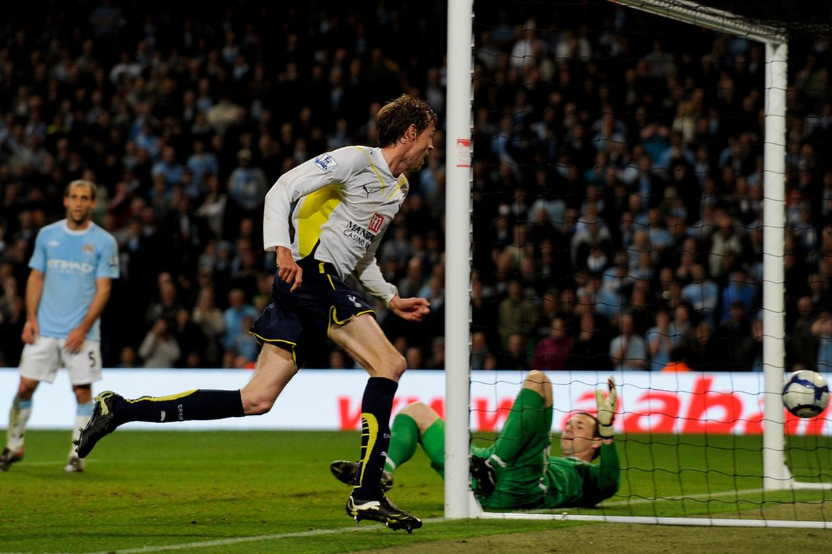 Peter Crouch wheels away after scoring the winner against Manchester City. (Picture from Getty Images).