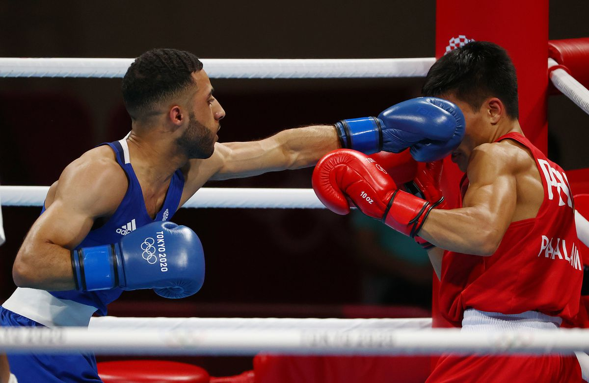 Boxing - Olympics: Day 15 - Galal Yafai of Team Great Britain punches Carlo Paalam of Team Philippines during the Men's Fly (48-52kg) Final