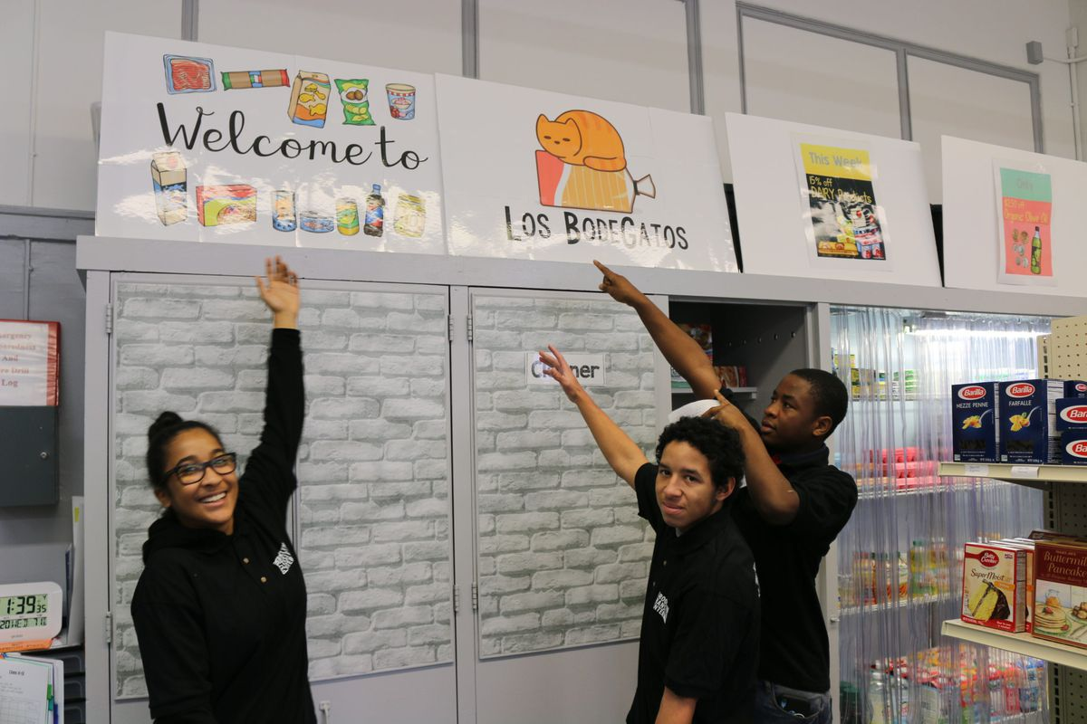 Students work in a mock bodega at the Brooklyn Transition Center.
