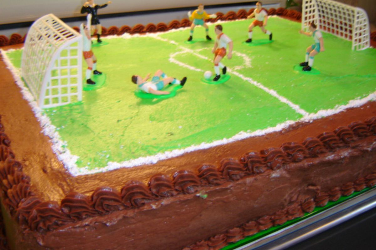 """Awesome soccer birthday cake picture courtesy of <a href=""""http://claudettesconfections.com"""" target=""""new"""">Claudettes Confections</a>."""