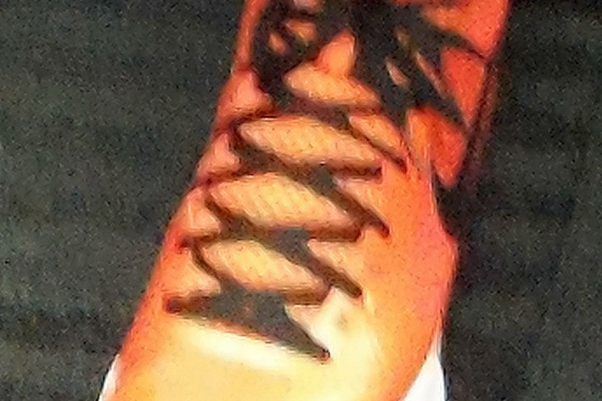 """Liz's custom orange all-star shoe, note the name on the tongue - """"Lizzy"""" not """"Lizzie"""", her preference is """"ie"""""""