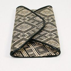 """This oragami clutch by On the Manor, $<a href=""""http://www.candystorecollective.com/collections/30-sale/products/oragami-clutch"""">30</a>, was $68"""