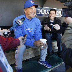 Toronto Blue Jays infielder Omar Vizquel laughs with reporters in the dugout before workouts in preparation for tomorrow's opening day major league baseball game against the Cleveland Indians at Progressive Field in Cleveland on Wednesday, April 4, 2012.  The next time Vizquel plays shortstop in a regular-season game he will become the oldest player in major league history to man that position.  He turns 45 on April 24.