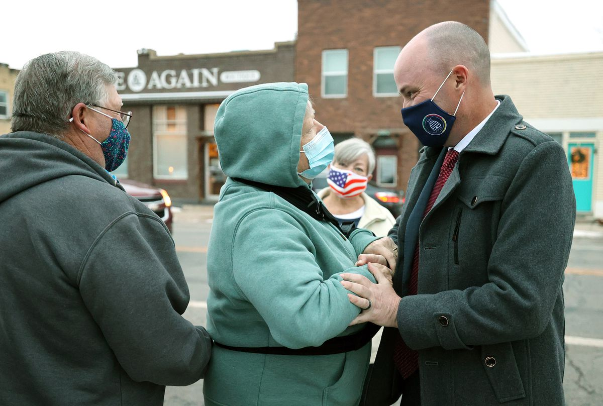 Utah Gov. Spencer Cox talks with friends as he is welcomed back to his hometown of Fairview, Sanpete County, as he and Lt. Gov. Deidre Henderson and their families make their way toward Salt Lake City after the inaugural ceremony earlier in the day at Tuacahn Center for the Arts in Ivins near St. George on Monday, Jan. 4, 2021.