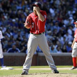 Washington Nationals relief pitcher Sean Burnett wipes his face during the eighth inning of a baseball game against the Chicago Cubs in Chicago, Sunday, April 8, 2012. The Cubs won 4-3.