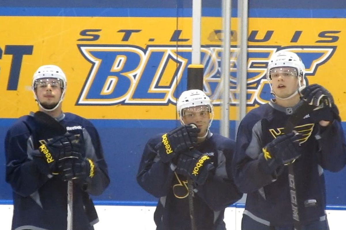 """From L to R:  Forwards C.J. Yakimowicz and Jaedon Descheneau, and defenseman Dmitrii Sergeev, are expected to be among the youngsters representing the Blues at this year's Traverse City Prospect Tournament. """"Game Time"""" photo by"""