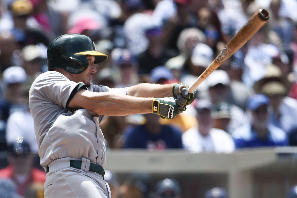 Scott Kazmir rakes an RBI single in June against the San Diego Padres.