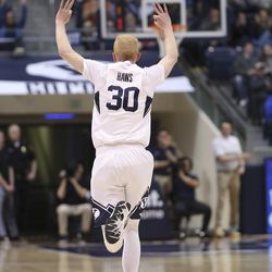 Brigham Young Cougars guard TJ Haws (30) celebrates his 3-pointer in Provo on Saturday, Feb. 8, 2020.