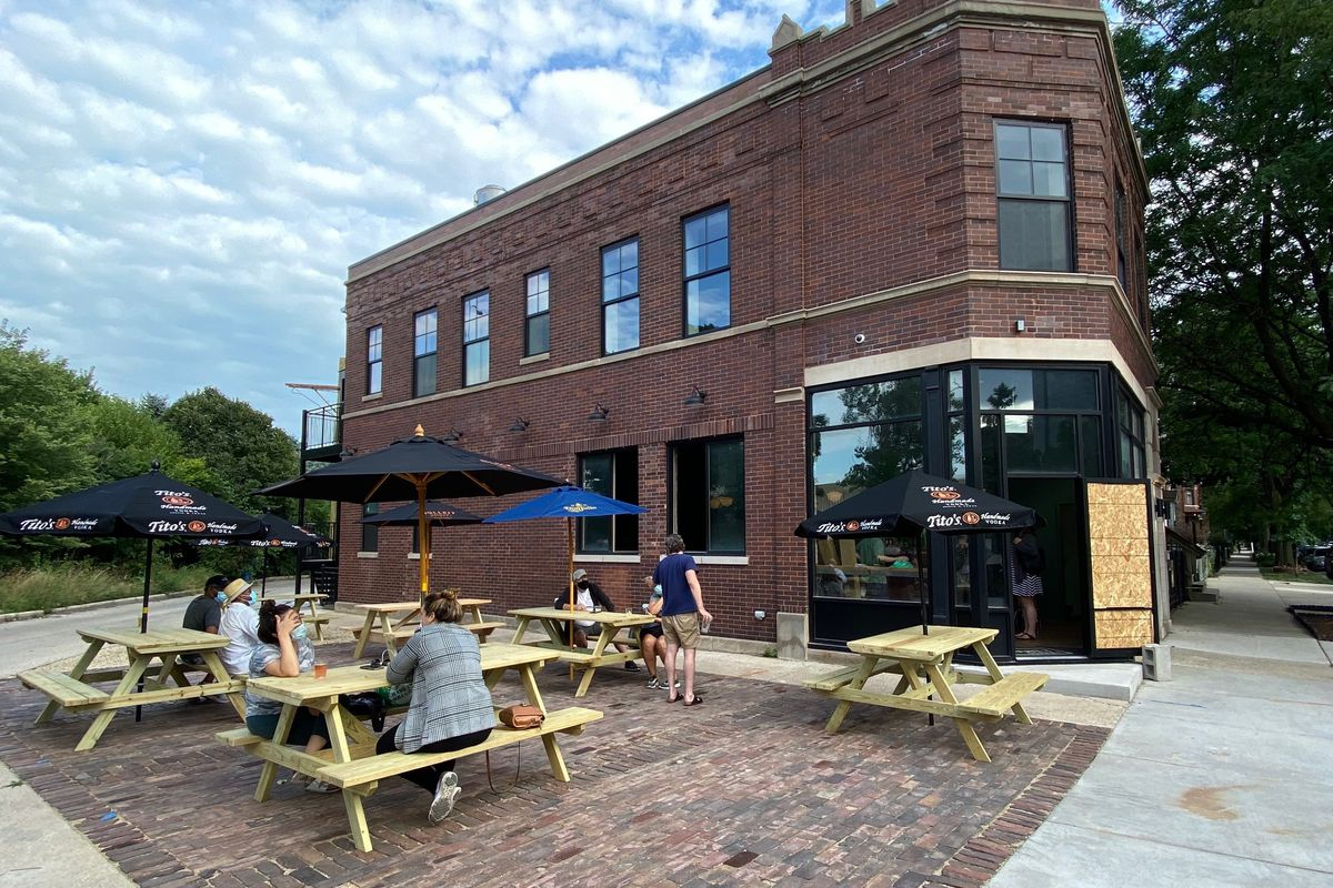 A large brick building with picnic tables
