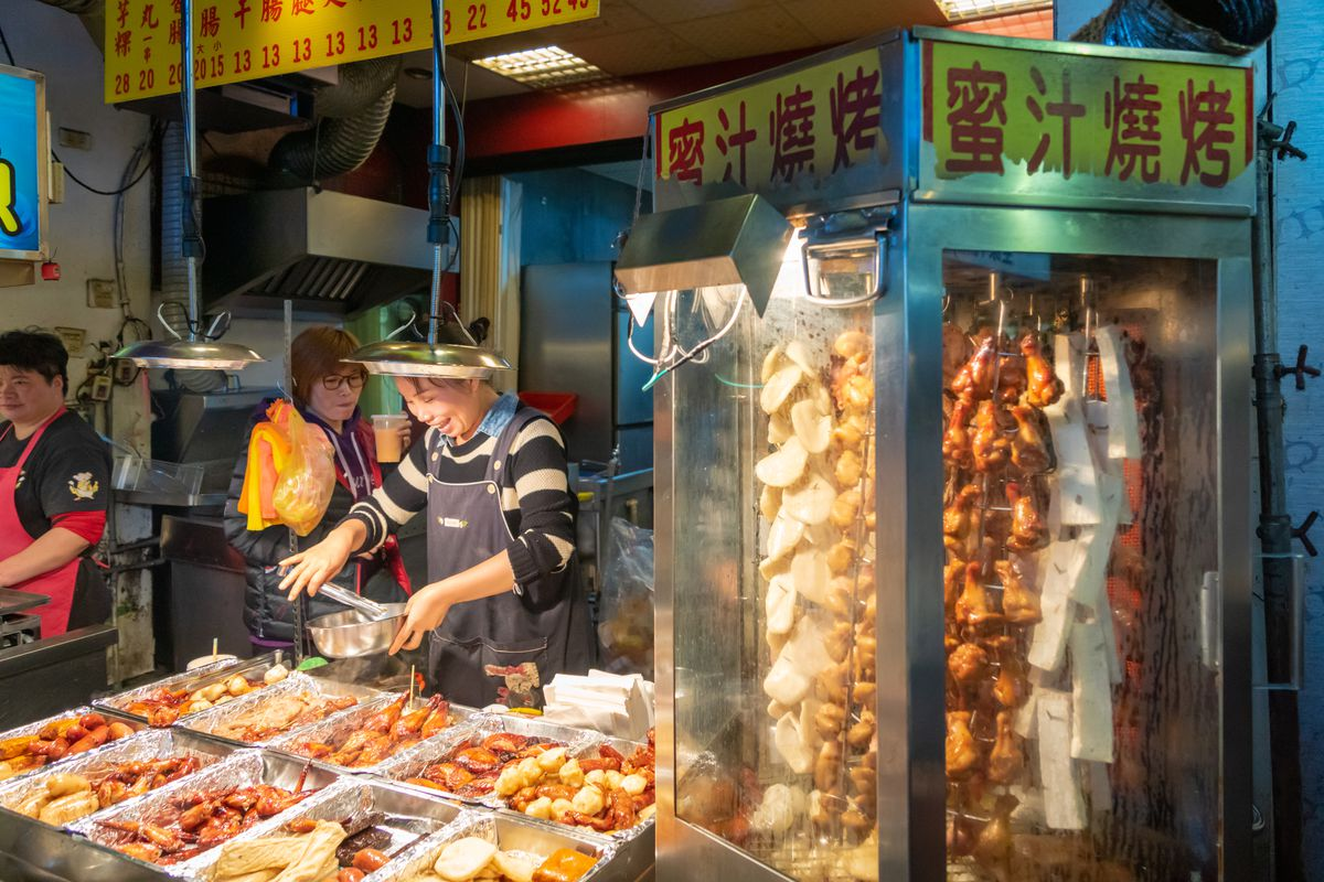 Street stall selling food in night market.