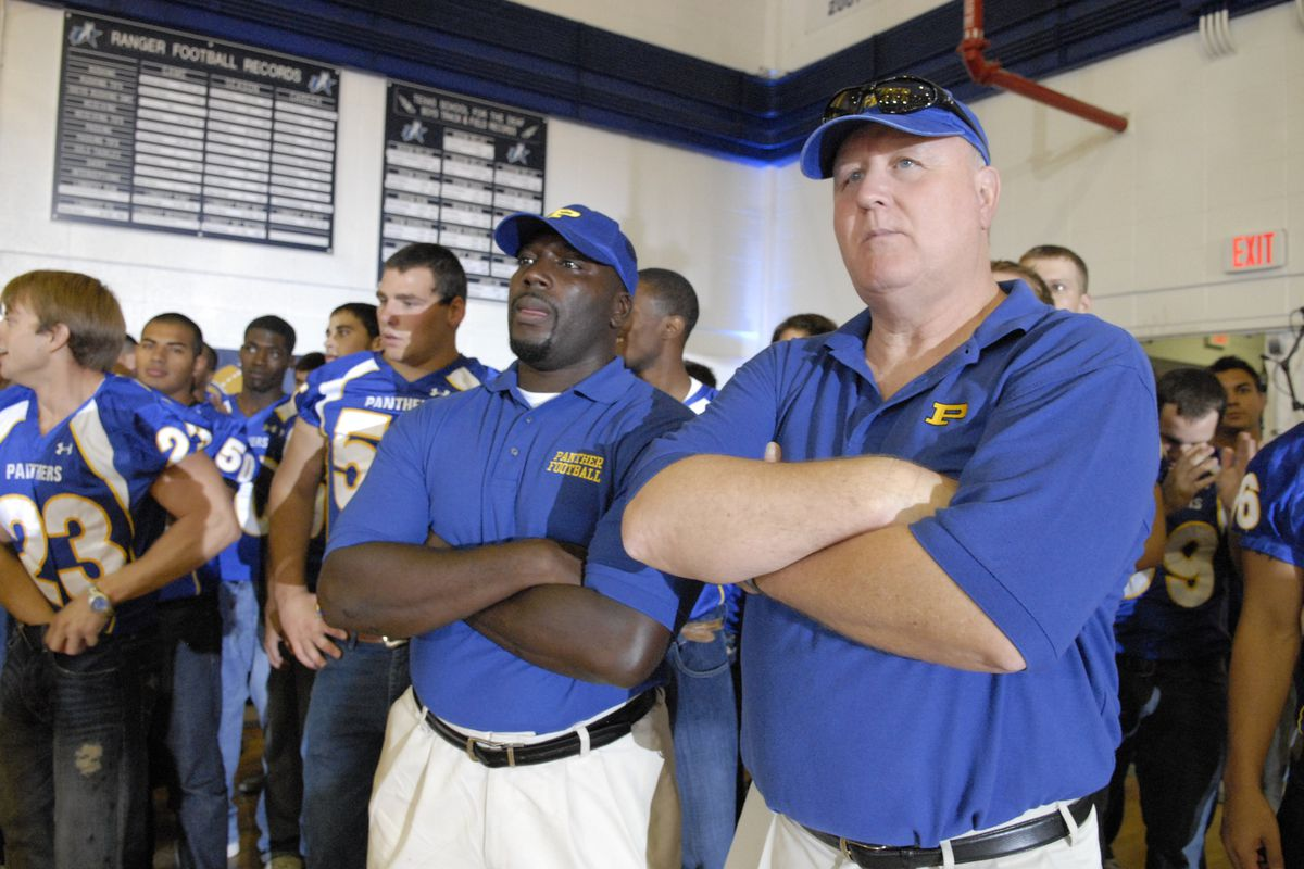 """FRIDAY NIGHT LIGHTS — """"East of Dillon"""" Episode 401 — Pictured: (l-r) Aaron Spivey-Sorrells as Coach Spivey, Timothy F. Crowley as Coach Crowley"""
