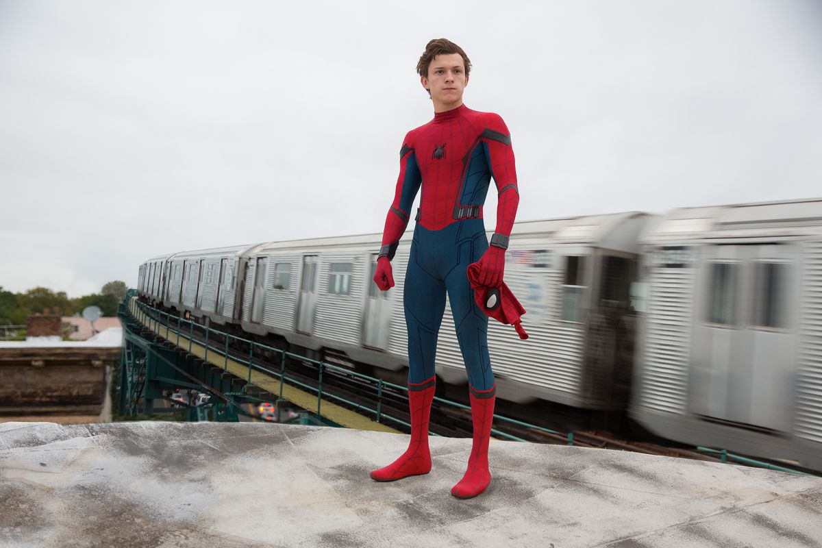 Spider-Man: Homecoming - a subway train goes by behind Spider-Man