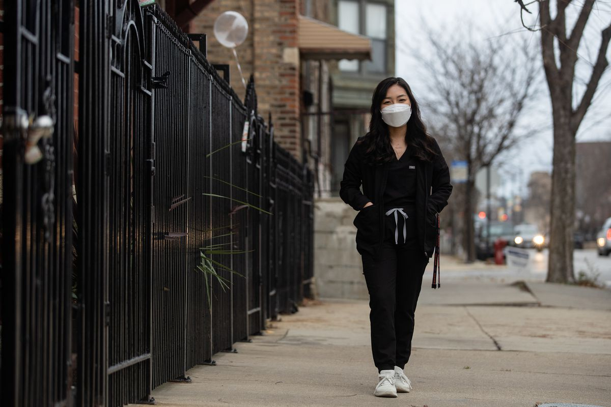 """Yearim Choi, 23, of Pilsen, and other Deferred Action for Childhood Arrivals recipients , poses for a picture in Pilsen, Saturday afternoon, Nov. 14, 2020. It was a """"sigh of relief"""" when she learned that Joe Biden is the projected winner of the 2020 election, but it is also an """"uphill battle,"""" she said."""