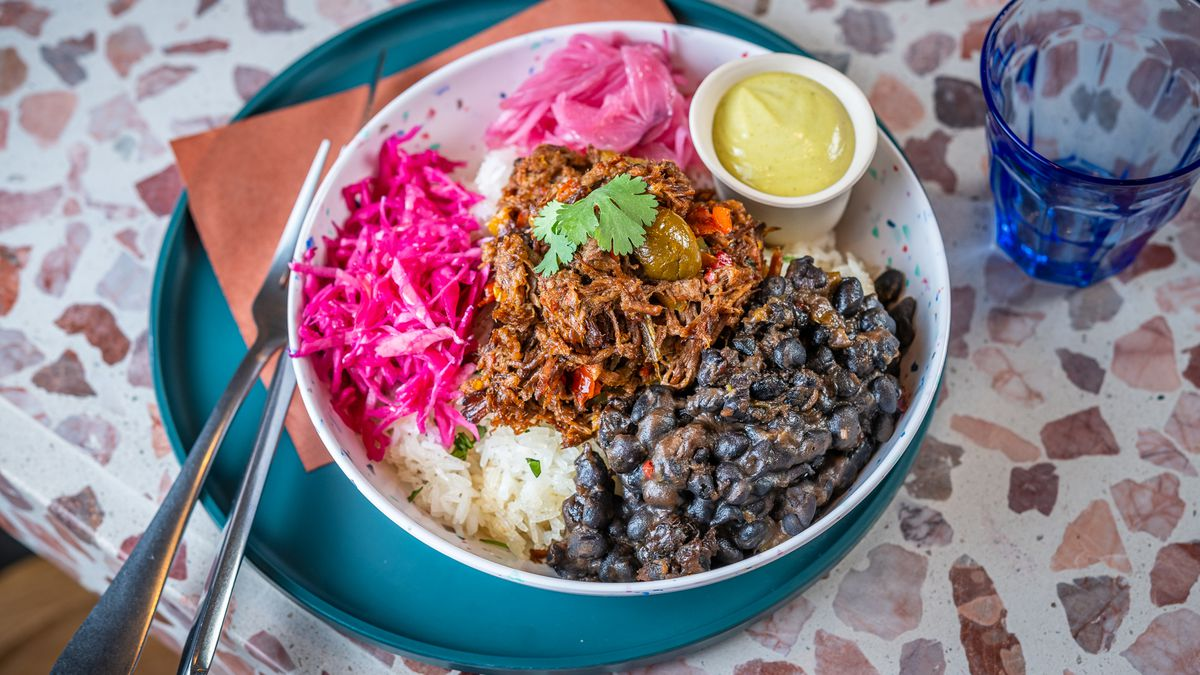 A cilantro rice bowl filled with black beans and ropa vieja from Colada Shop's new location on the Southwest Waterfront