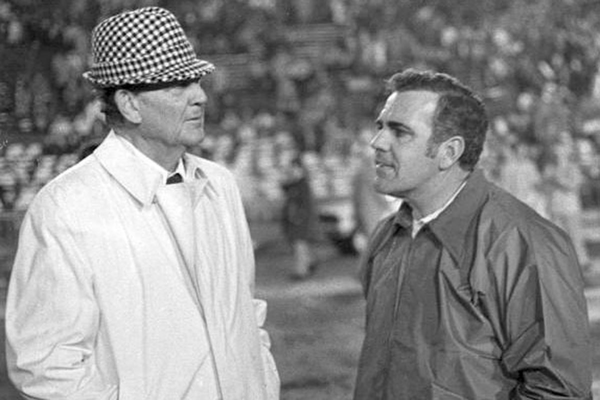Alabama's Paul W. Bryant and Notre Dame's Ara Parseghian meet on the field of Tulane Stadium prior to the Sugar Bowl on Dec. 31, 1973.