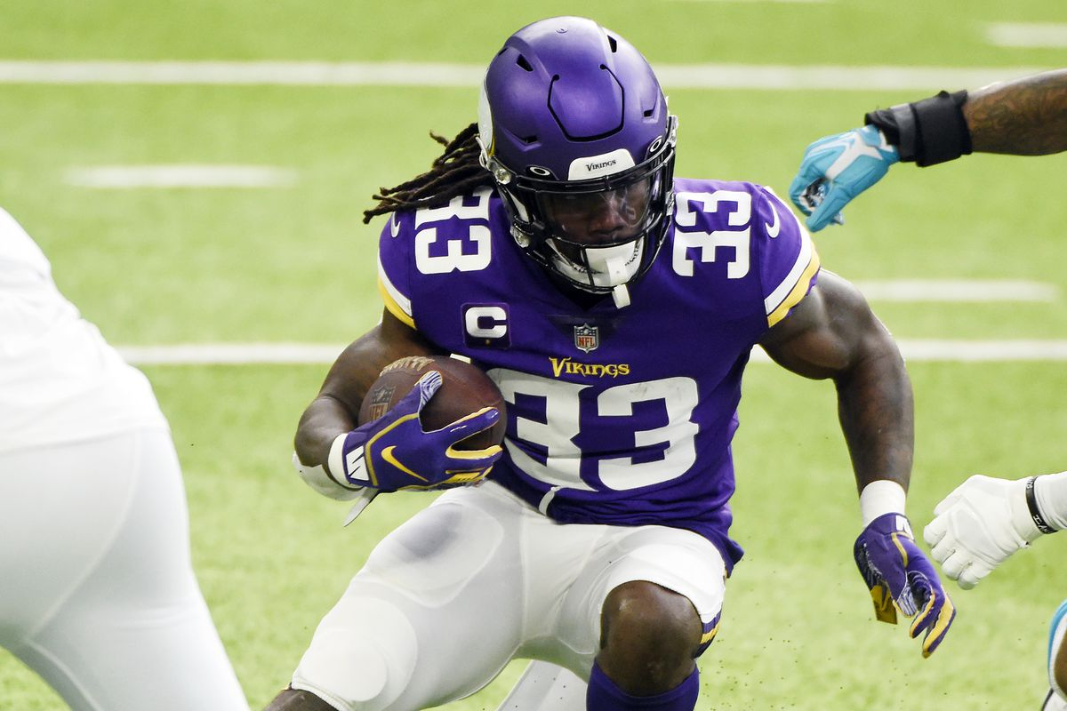 Dalvin Cook #33 of the Minnesota Vikings runs with the ball during the first half against the Carolina Panthers at U.S. Bank Stadium on November 29, 2020 in Minneapolis, Minnesota.