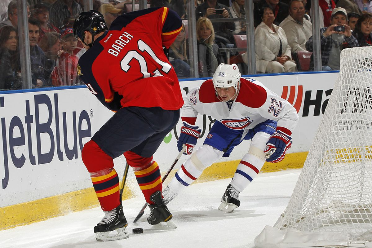 SUNRISE, FL - DECEMBER 31: Tomas Kaberle #22 of the Montreal Canadiens checks the puck away from Krystofer Barch #21 of the Florida Panthers on December 31, 2011 at the BankAtlantic Center in Sunrise, Florida. (Photo by Joel Auerbach/Getty Images)